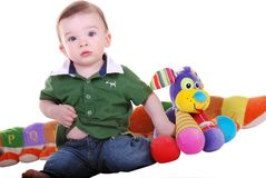 Baby boy with toys. Royalty Free Stock Image