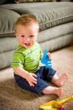Baby Boy with Toys Stock Images