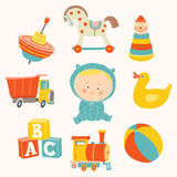 Baby boy with toys : ball, blocks, rubber duck, rocking horse, toy train, pyramid, spinning top, toy truck. Royalty Free Stock Images