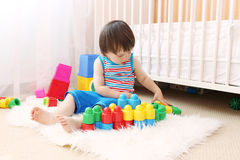 Baby boy with toys at home Royalty Free Stock Image