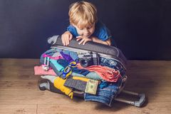 Baby boy and Travel Suitcase. Kid and Luggage Packed for Vacatio. N Full of Clothes, Child and Family Trip Stock Images