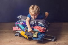 Baby boy and Travel Suitcase. Kid and Luggage Packed for Vacatio. N Full of Clothes, Child and Family Trip Stock Image