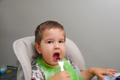 Baby boy trying eat Royalty Free Stock Photos