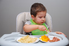 Baby Boy Trying Eat With A Little Fork Royalty Free Stock Image