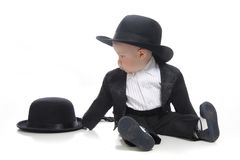 Baby boy in tuxedo and hat