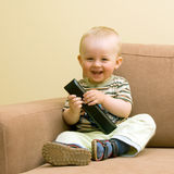 Baby boy with TV remote royalty free stock photos