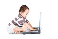 Baby boy typing on laptop Stock Photography