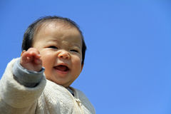 Baby boy under blue sky Stock Photography