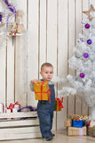 Baby boy under Christmas fir tree Royalty Free Stock Image
