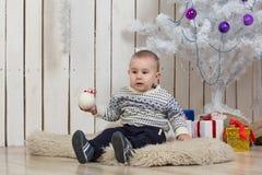 Baby boy under Christmas fir tree Stock Photography