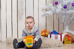 Baby boy under Christmas fir tree Stock Photography