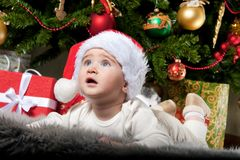 Baby boy under christmas tree Royalty Free Stock Photo