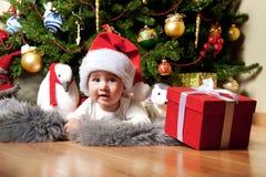 Baby boy under christmas tree Royalty Free Stock Photography