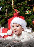 Baby boy under christmas tree Royalty Free Stock Images