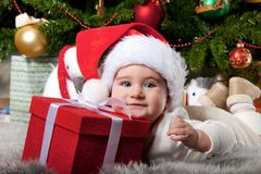 Baby boy under christmas tree Royalty Free Stock Photography