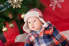 Baby boy under christmas tree Royalty Free Stock Image