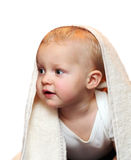 Baby boy under towel stock photography