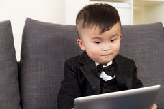Baby boy using digital tablet Royalty Free Stock Image