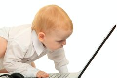 Baby boy using a laptop computer Royalty Free Stock Photos