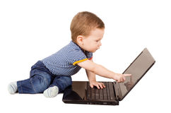 Baby boy using laptop. Cute little baby boy using laptop isolated on white background Stock Photos