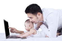 Baby boy using laptop with his dad Royalty Free Stock Photo
