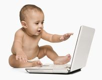 Baby boy using a laptop Stock Photo
