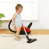 Baby boy with vacuum cleaner Royalty Free Stock Photos