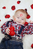 Baby boy with valentines heart Royalty Free Stock Photos