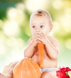 Baby boy with vegetables Royalty Free Stock Image