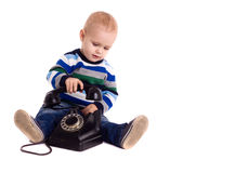The baby boy with vintage black phone Royalty Free Stock Image