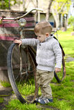 Baby boy walking around the old bike Stock Photo