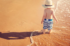 Baby boy are walking on the beach Royalty Free Stock Images