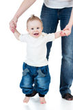 Baby boy walking with help of mothers hands Royalty Free Stock Images