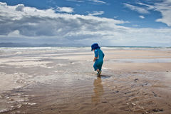 Baby boy walking on large beach Stock Photo