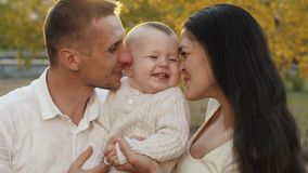 Happy family with child on nature stock video