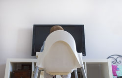 Baby boy watching Childrens TV programs stock photos