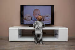 Baby boy watching television Royalty Free Stock Images