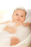 Baby boy in water tub Royalty Free Stock Photos