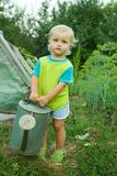 Baby boy with watering pot Stock Photos