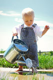 Baby Boy Watering Sidewalk Royalty Free Stock Photography