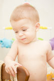 Baby boy. Waving hand and standing up in crib Royalty Free Stock Photo