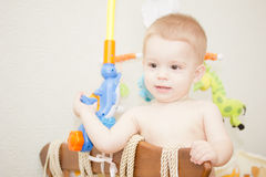 Baby boy. Waving hand and standing up in crib Stock Photography