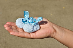 A baby boy is on the way. A future mother holding a pair of shoes for future baby boy Stock Photos