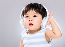 Baby boy wear headphone Royalty Free Stock Photography