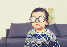 Baby boy wear thick glasses stock images