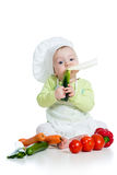Baby boy eating healthy food vegetables Royalty Free Stock Image