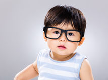 Baby boy wearing eye glasses. With grey background royalty free stock images