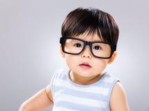 Baby boy wearing eye glasses Royalty Free Stock Images