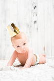 Baby boy with wearing a golden crown Stock Photography