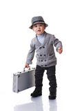 Baby boy wearing a hat holding silver case Royalty Free Stock Images